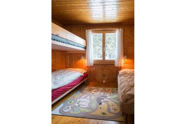 Kinderzimmer im Obergeschoss mit max. drei Betten