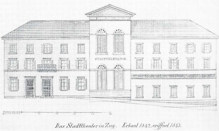 Das Stadttheater Zug wird 1843 eröffnet und 1904 aus Sicherheitsgründen geschlossen. Heute steht an dieser Stelle das kantonale Verwaltungsgebäude am unteren Postplatz. (Bild Zuger Neujahrsblatt)