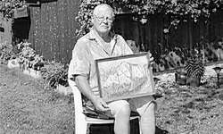 Adi Oechslin mit seinem ersten Öl-Bild «Bockmattli» im Garten seines Sommerhäuschens in Bäch. Bild Raffaela Heusser